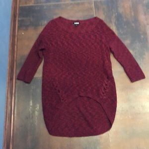 Long red sweater with quarter length sleeves